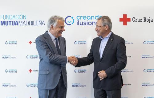 Ignacio Garralda presidente de Fundación Mutua (izda.) y Javier Senent presidente Cruz Roja (dcha.)